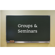 A photo of a blackboard with the words Groups and Seminars written on it.