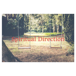 A photo of two swings hanging from a tree in a forest, facing a path.  Spiritual Direction